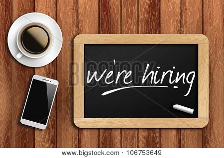 Coffee, Phone  And Chalkboard With  Word We're Hiring