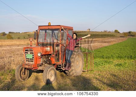 Girl In The Tractor On Farmland