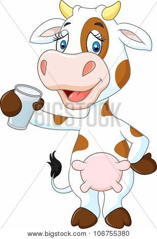 Happy cow animal holding a glass of milk isolated on white background