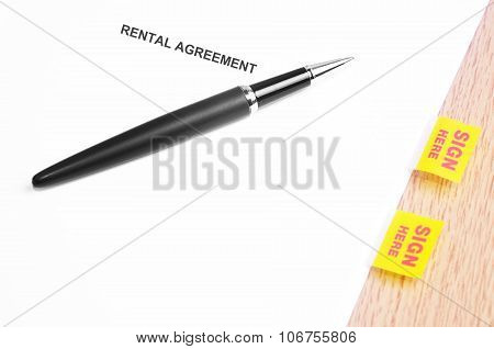 Black Pen And Rental Agreement With Sign Here Stickers