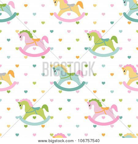 Rocking horses and hearts children seamless pattern