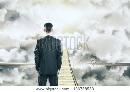 Businessman Is Walking On Air Bridge Among The Clouds Concept