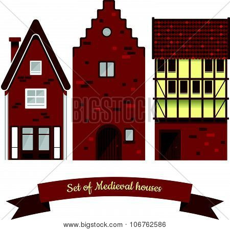 Set of three European medieval houses in burgundy shades. Dutch and German traditional historic arch
