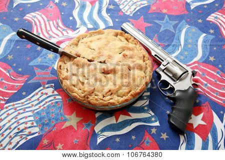 Fresh Apple Pie and a 44. Magnum Pistol on an American Flag Pattern Background. Nothing says AMERICA better than Apple Pie.
