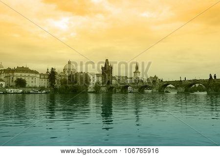 Charles Bridge And Vltava River On Sunset