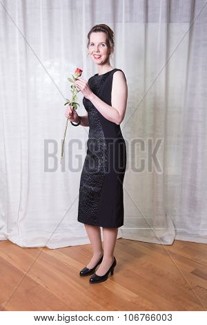 Portrait Attractive Woman With Rose In Her Hand