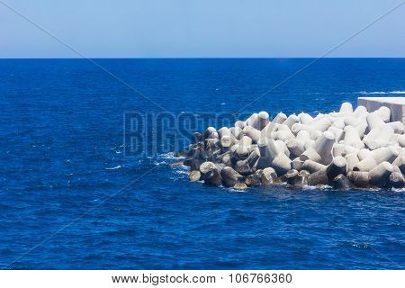 Blue Seaview With Breakwaters Of Bari