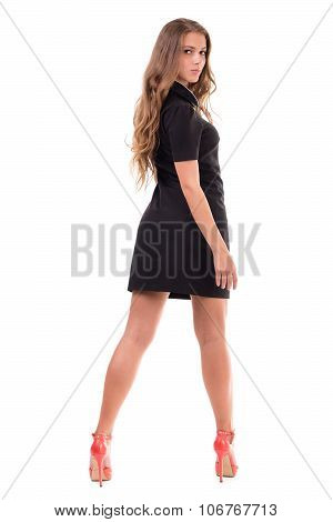 Full length of sensual woman in short dress posing against isolated white