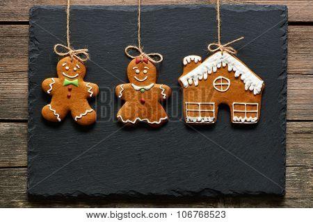 Christmas homemade gingerbread couple cookies over slate