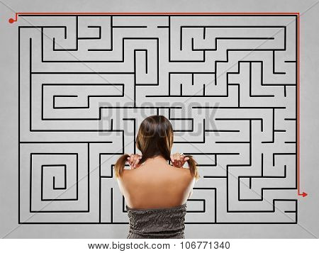 Woman Pulling Hair In Front Of Labyrinth With Alternative Soluti