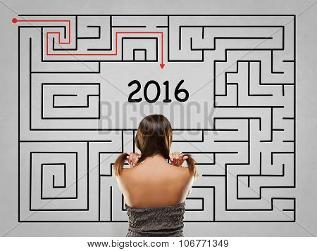 Woman Pulling Hair In Front Of Labyrinth With 2016 Solution