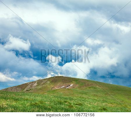 Summer Green Mountain Top And Cloudy Sky