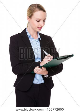 Caucasian young businesswoman take note on clipboard
