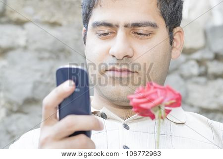 Rural Man With A Rose And A Mobile