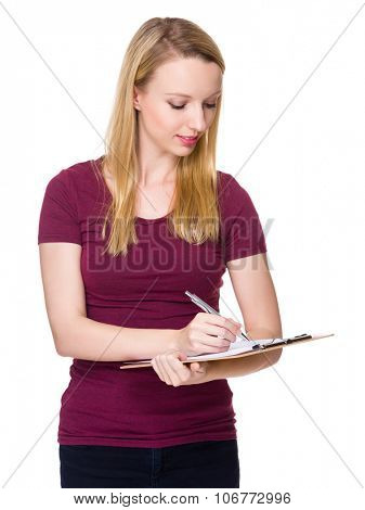 Caucasian young woman write on the clipboard