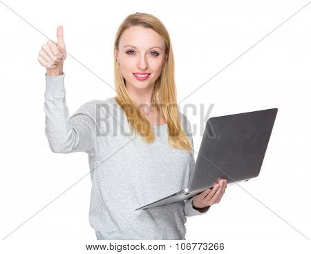 Caucasian woman hold with notebook computer and thumb up