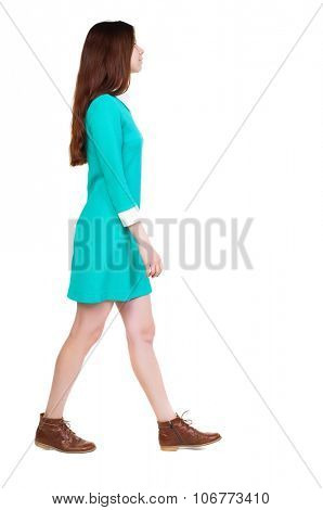 back view of walking  woman. beautiful girl in motion.  backside view of person.  Rear view people collection. Isolated over white background.