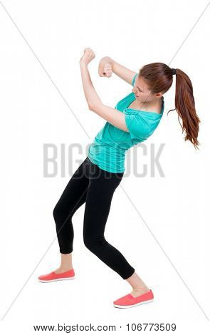 skinny woman funny fights waving his arms and legs. Rear view people collection.  backside view of person.  Isolated over white background. Sportswoman in tights deviates from the impact.