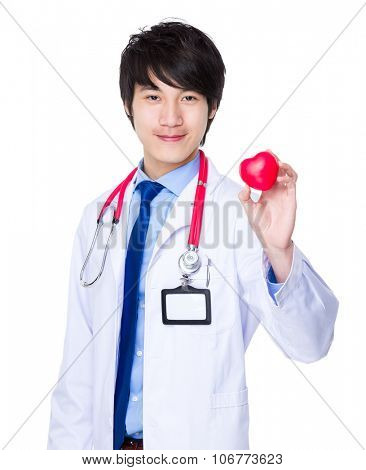 Doctor hold up with heart ball