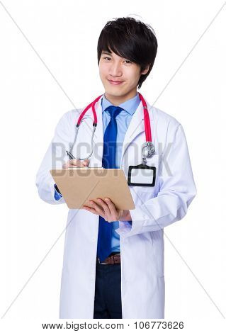 Young doctor take note on clipboard
