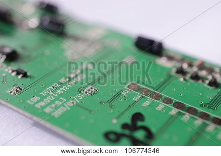 Microchip circuit board close up green on white background