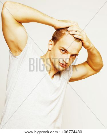 young handsome man on white background gesturing, pointing, posing emotional, cute guy blond hair