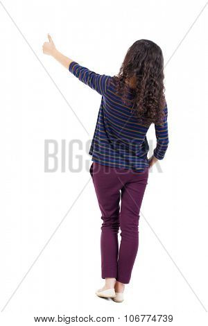 Back view of  woman thumbs up. Rear view people collection. backside view of person. Isolated over white background. Thrusting one hand in the pocket of the second girl shows gesture