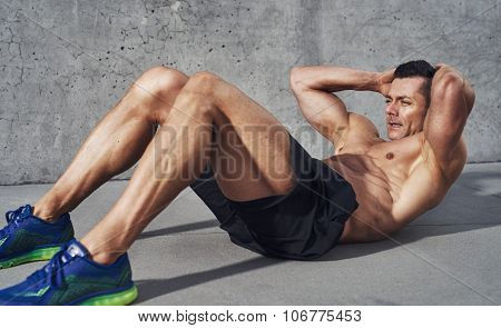 Muscular Man Exercising Doing
