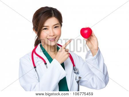 Asian Doctor show with heart ball