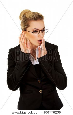 Young businesswoman overhears a conversation