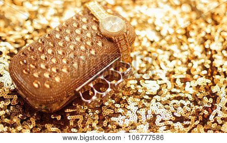 Fashion Golden Womens Accessories. Rich Wristwatch And Purse, On Golden Sequins Sparkling Sequined T