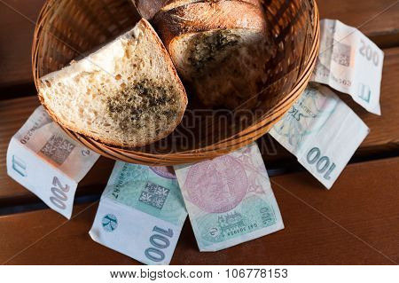 Fresh roasted bread with melted butter and spicy herbs and Czech banknotes