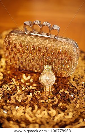 Fashion Golden Womens Accessories. Rich Wristwatch And Purse, On Yellow Sequins Sparkling Sequined T