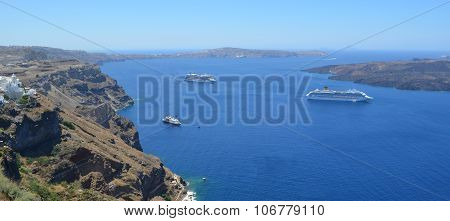 Cruise liners moored in the caldera visitng Santorini.