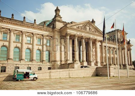 Police Car Parked Past Historical Reichstag Building - German Parliament