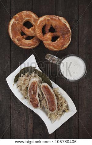 German white sausages with sauerkraut, pretzel and beer