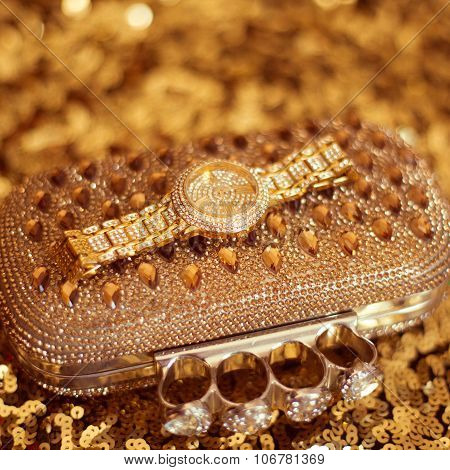 Luxury Rich Golden Wristwatch And Purse, On Golden Sequins - Sparkling Sequined Textile. Women Acces