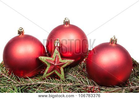 Star And Red Xmas Baubles On Green Firtree Branch