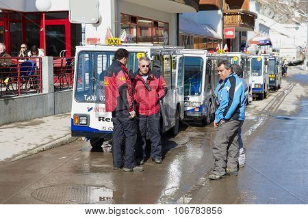 Electric taxi drivers talk at the parking lot in Zermatt, Switzerland.