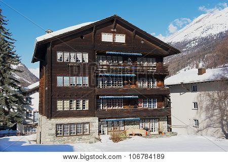 Exterior of the traditional wooden chalet in Zermatt, Switzerland.