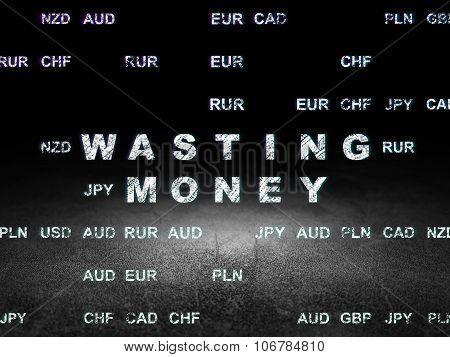 Money concept: Wasting Money in grunge dark room