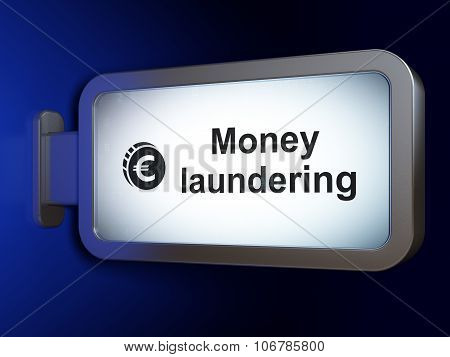 Money concept: Money Laundering and Euro Coin on billboard background