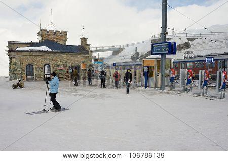 People walk at the upper Gornergratbahn railway station in Zermatt, Switzerland.