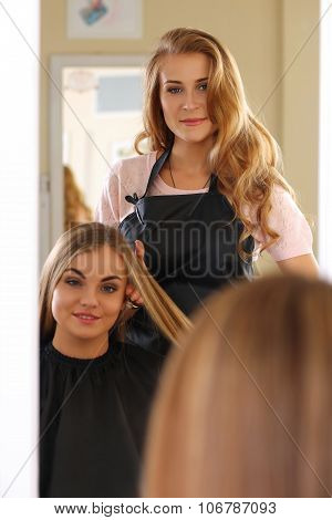 Reflection Of Beautiful Blonde Female Hairdresser