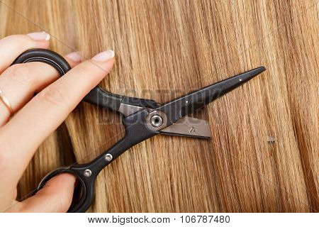 Female Hand Holding Hot Thermal Scissors