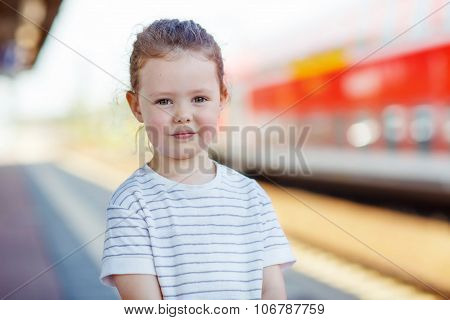 Cute Little Girl On A Railway Station.