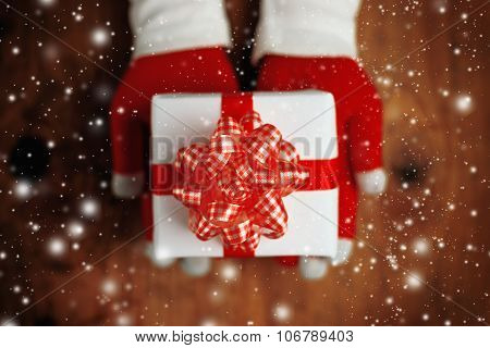 Woman Offering Christmas Gift In Wrapped Box