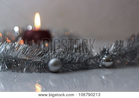 Greeting Card Made Of Silver Tinsel With Silver Christmas Balls And Red Burning Candle