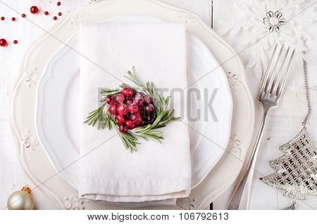 Christmas And New Year Holiday Table Setting with cranberry  decoration.
