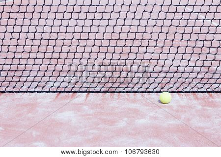 Ball And Net On A Paddle Court